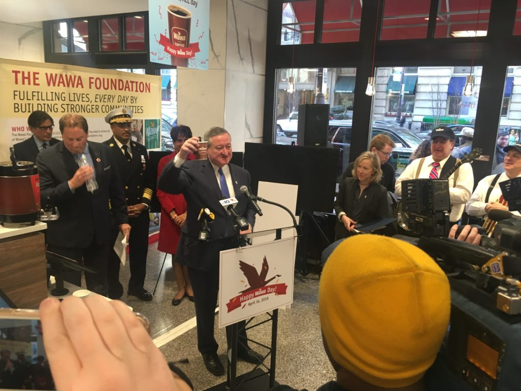Mayor Jim Kenney toasts Wawa with a cup of his favorite coffee