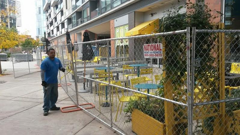 The fence installed in front of PYT before the Forbes Under 30 Concert. The restaurant closed down in October 2015.