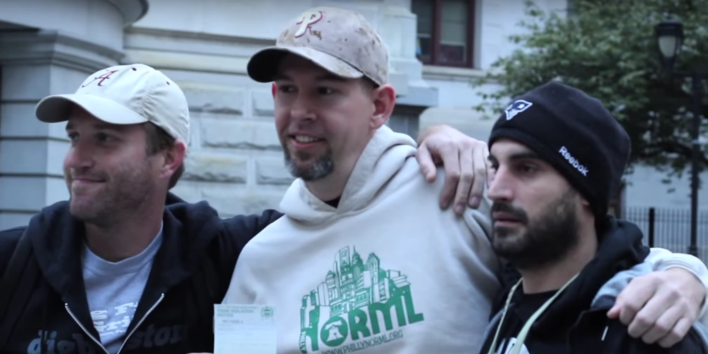 Marijuana activists pose with pride after the reported first mariju citation is issued in 2014.
