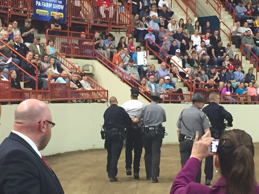 A protester is escorted out of the Donald Trump rally.