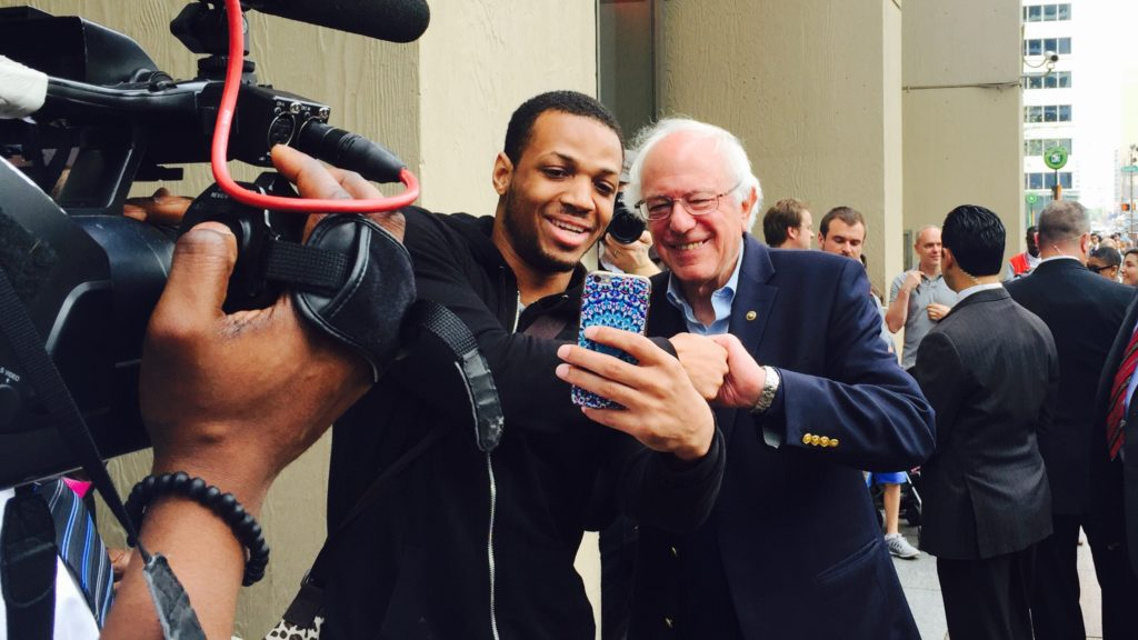 Bernie Sanders takes selfies with voters outside Philadelphia City Hall on Election Day.