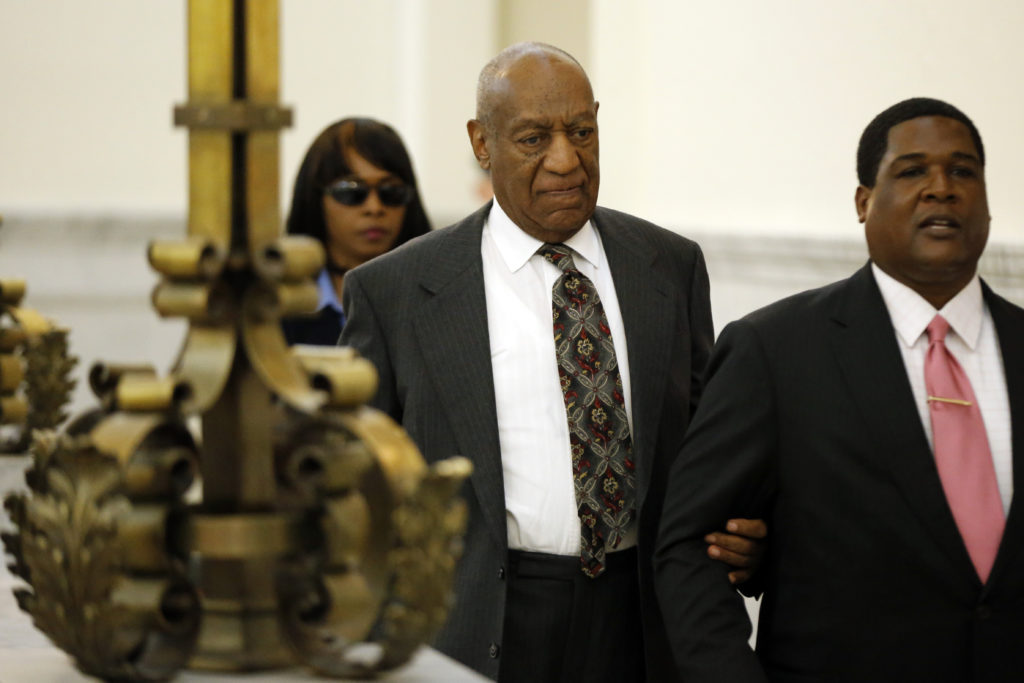 Bill Cosby departs the Montgomery County Courthouse after a preliminary hearing, Tuesday, May 24, 2016, in Norristown, Pa. Cosby was ordered to stand trial on sexual assault charges after a hearing that hinged on a decade-old police report. (AP Photo/Matt Rourke, Pool)