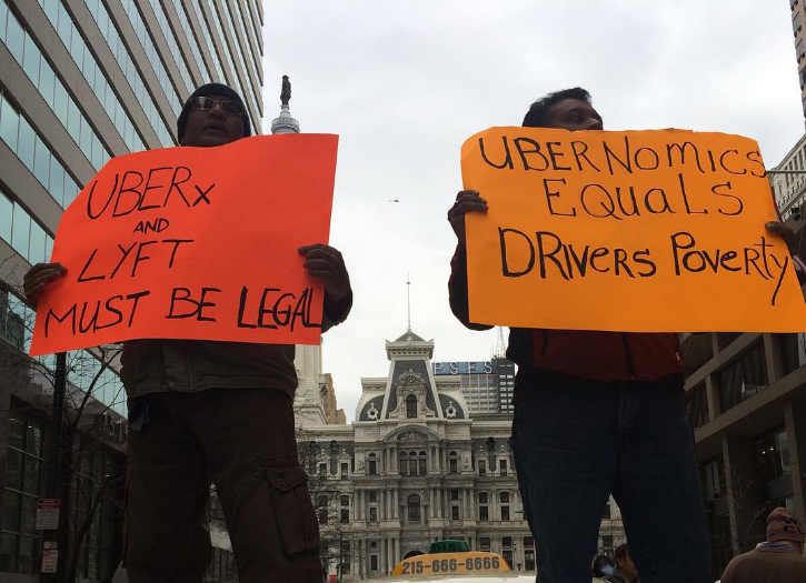 Taxi, limo and Uber Black drivers protest UberX in Philadelphia in May 2016.