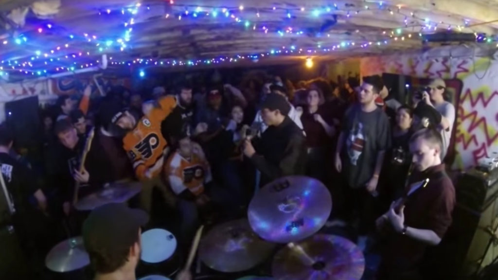 The band Varials plays a basement show.