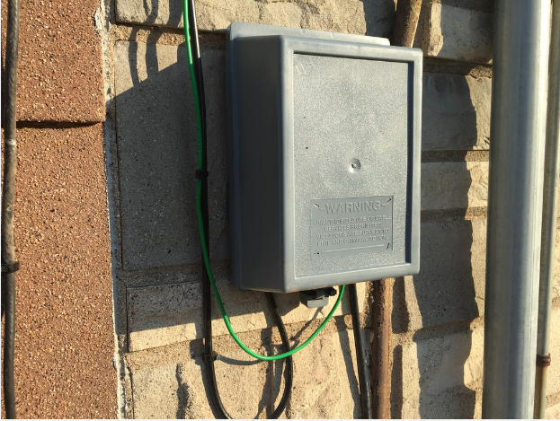 comcast will bolt this box full of their wires onto your house Cable Box Equipment