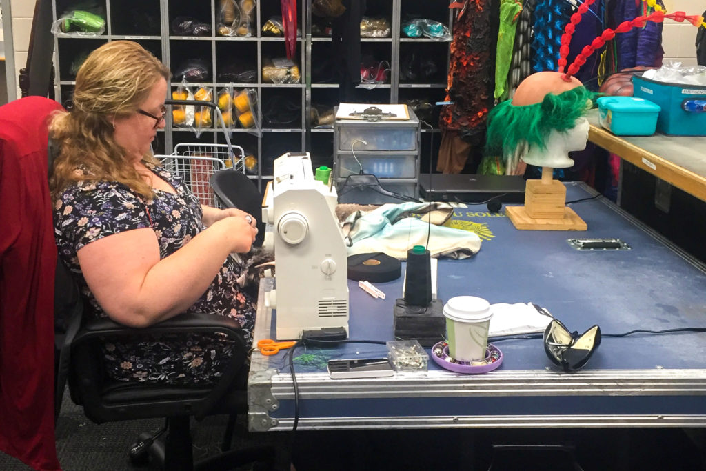 Costumer Julie O'Brien finishes up an Ovo costume