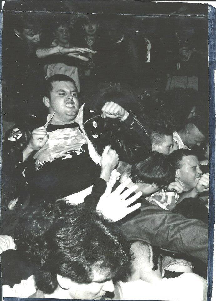 Bandoch at a Black Flag concert in 1982,  post-stage dive at the East Side Club.