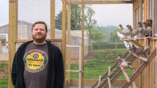 Scott Schroeder of Hungry Pigeon with the King pigeons bred for his restaurant