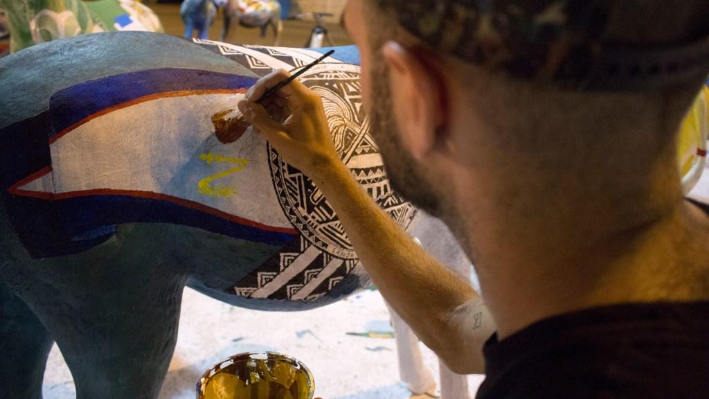 Andrew Joseph Grasso paints the donkey that represents American Samoa.