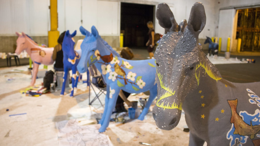 The closest donkey represents Alaska, and the next donkey represents North Carolina. Both were painted by Sarah Ryan.