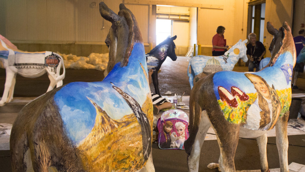 Donkeys are being painted to represent different states and U.S. territories, Democrats Abroad and Washington D.C.