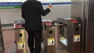 SEPTA General Manager Jeffrey Kneuppel uses a Key card at a turnstile in the concourse under Dilworth Park