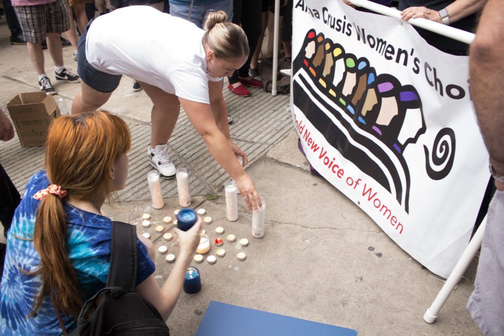 People set up candles for the candlelight vigil in remembrance of those who were killed in Orlando.