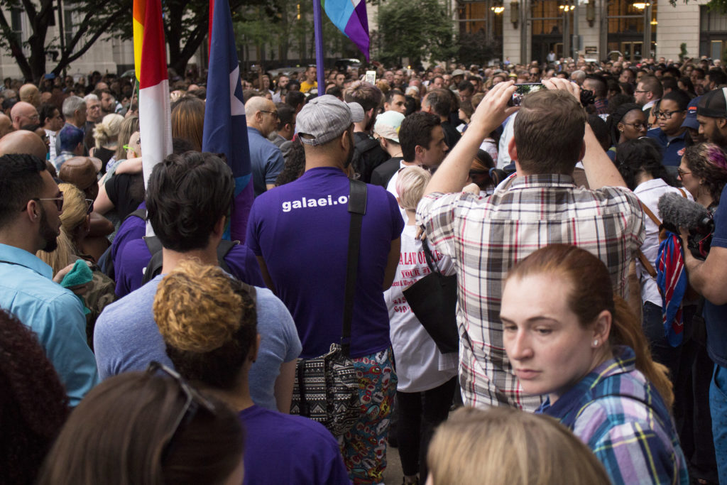 Supporters packed City Hall to remember the 49 people killed in the Orlando shooting