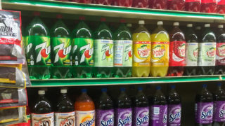 Shelves are stocked with sugary drinks at Cousins Grocery Store in Philadelphia.