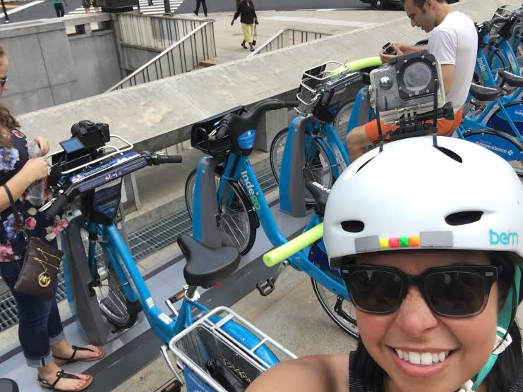 Brave intern Jenna Eason (far left) mounts her camera to a bike basket as Reporter Mark Dent secures the pool noodles. I wore my helmet camera.