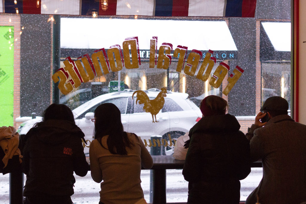 Customers gather inside the Center City FedNuts during a snowstorm