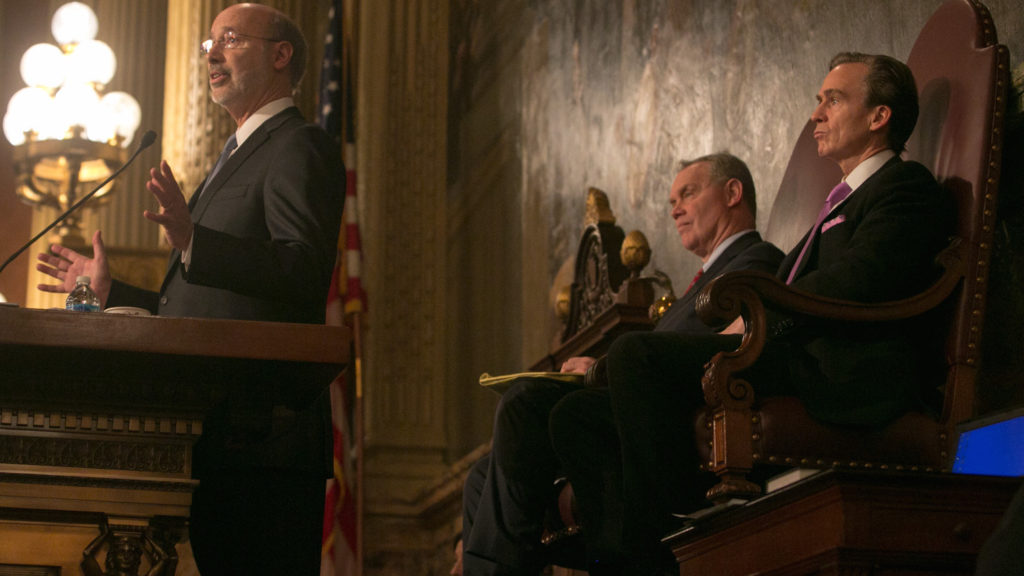 Governor Tom Wolf giving a budget address this February, as Speaker Mike Turzai and Lieutenant Governor Mike Stack look on.