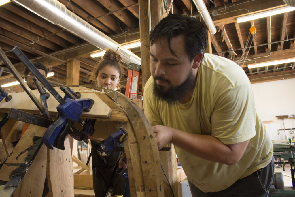Jesus Castro works with students at the Philadelphia Wooden Boat Factory.