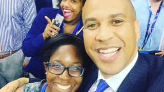 Cory Booker poses with a DNC attendee.
