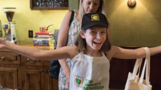 Ava Terosky tries on her new Vetri Community Partnership gear