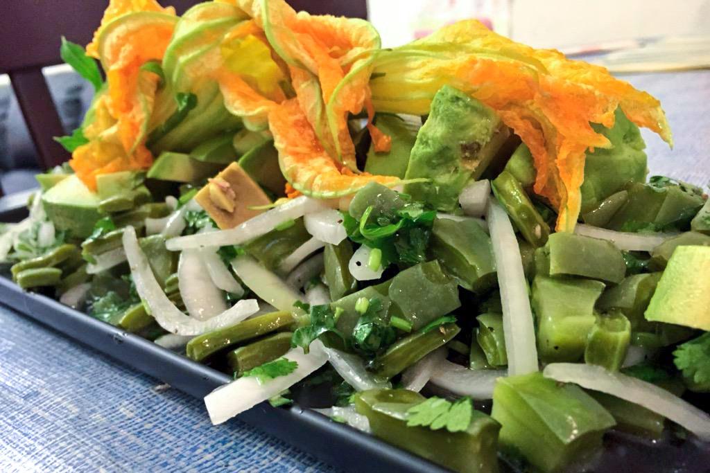 A salad of nopales (cactus), avocado and squash blossom