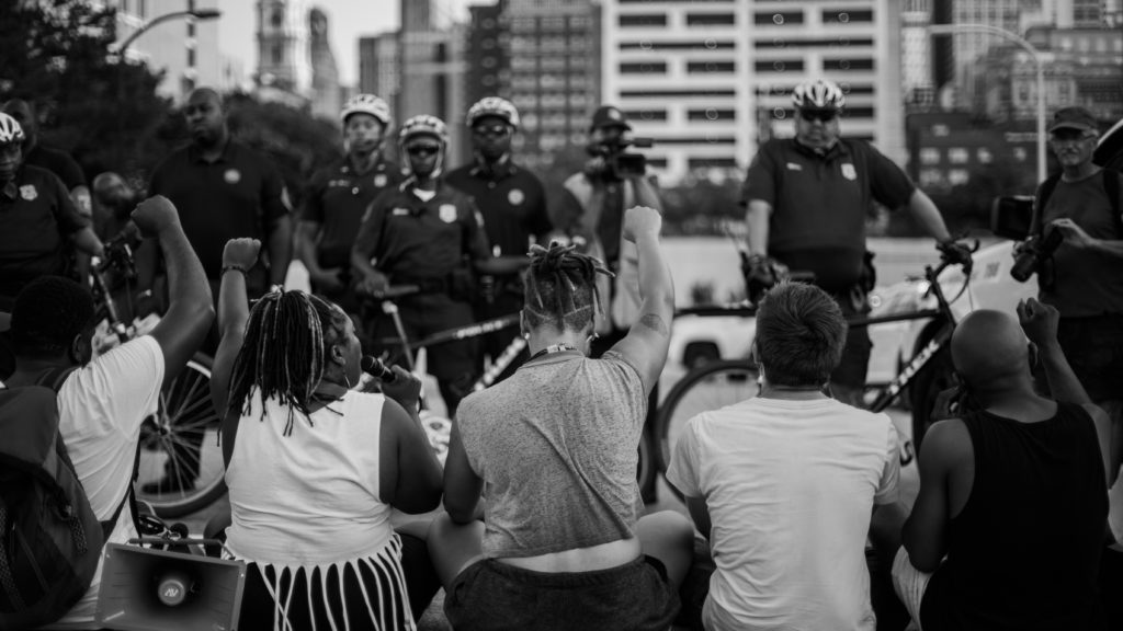 Protesters sit in the street during a protest in Philadelphia a day after Alton Sterling was killed in Louisiana.