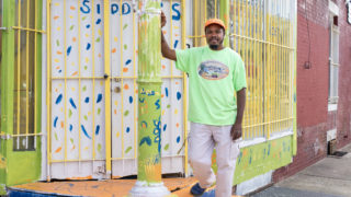 Siddiq Moore in front of the future flagship location of Siddiq's Real Fruit Water Ice