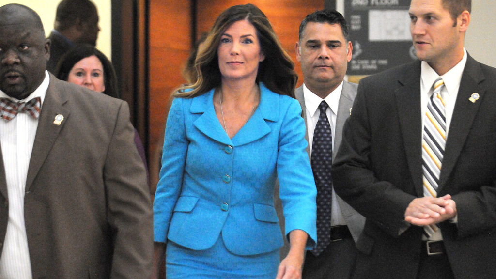 Pa. Attorney General Kathleen Kane enters the Montgomery County courtroom.