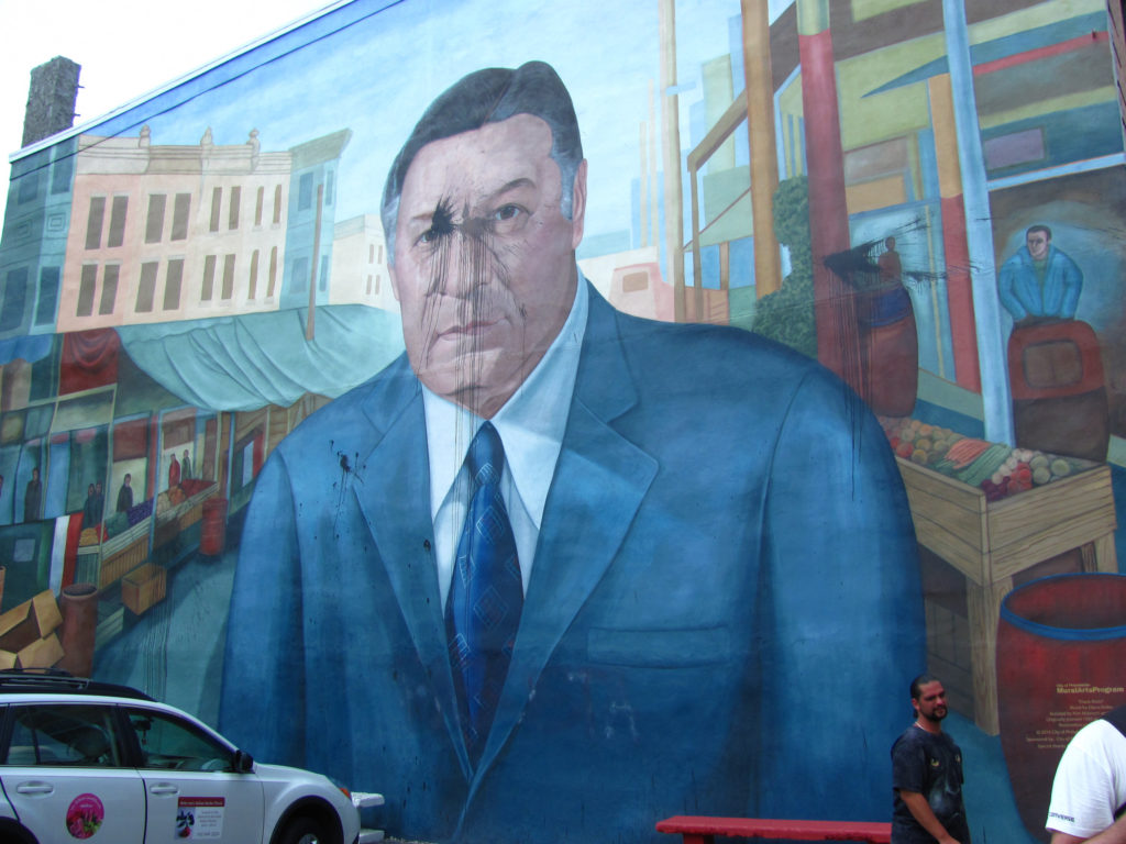 A mural in South Philadelphia depicting Rizzo, after it was defaced in 2012. The mural gets vandalized more than any other in Mural Arts' collection. It was defaced again last month.