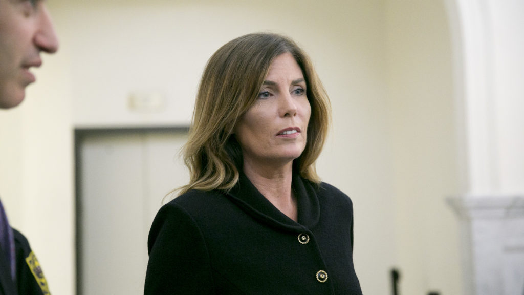 Kathleen Kane exits the courtroom where jurors were read the charges against her at the Montgomery County Courthouse.