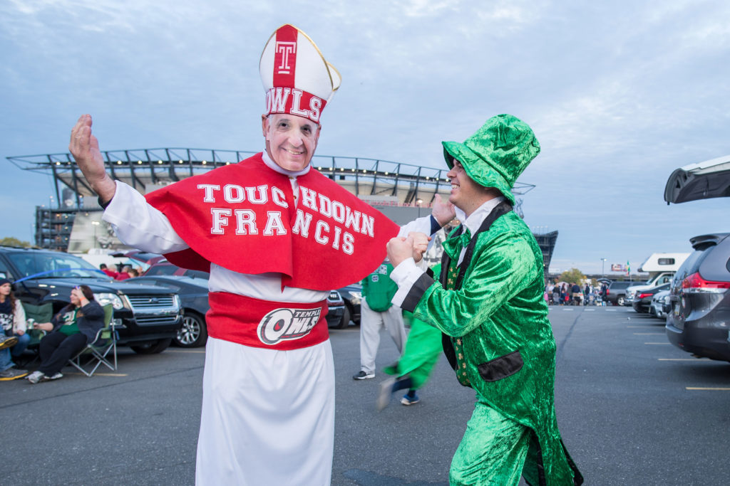 iOct 31, 2015; Philadelphia, PA, USA; Len Donnelly of Horsham, PA, dressed as Pope Francis, and Rusell De Lacy of Stamford, CT, dressed as the Notre Dame Leprechaun, pose for a photo outside Lincoln Financial Field before the game between the Temple Owls and the Notre Dame Fighting Irish. Mandatory Credit: Matt Cashore-USA TODAY Sports