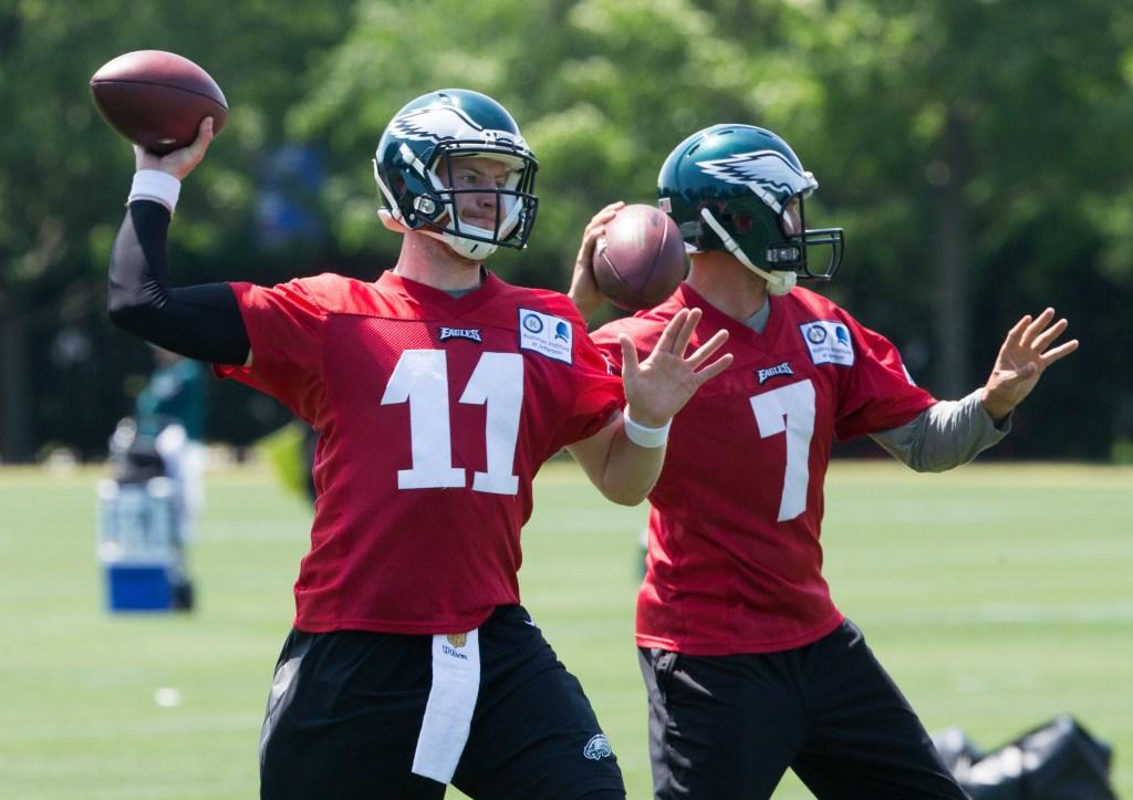 Jun 9, 2016; Philadelphia, PA, USA; Philadelphia Eagles quarterback Carson Wentz (11) and quarterback Sam Bradford (7) throw during mini camp at NovaCare Complex.