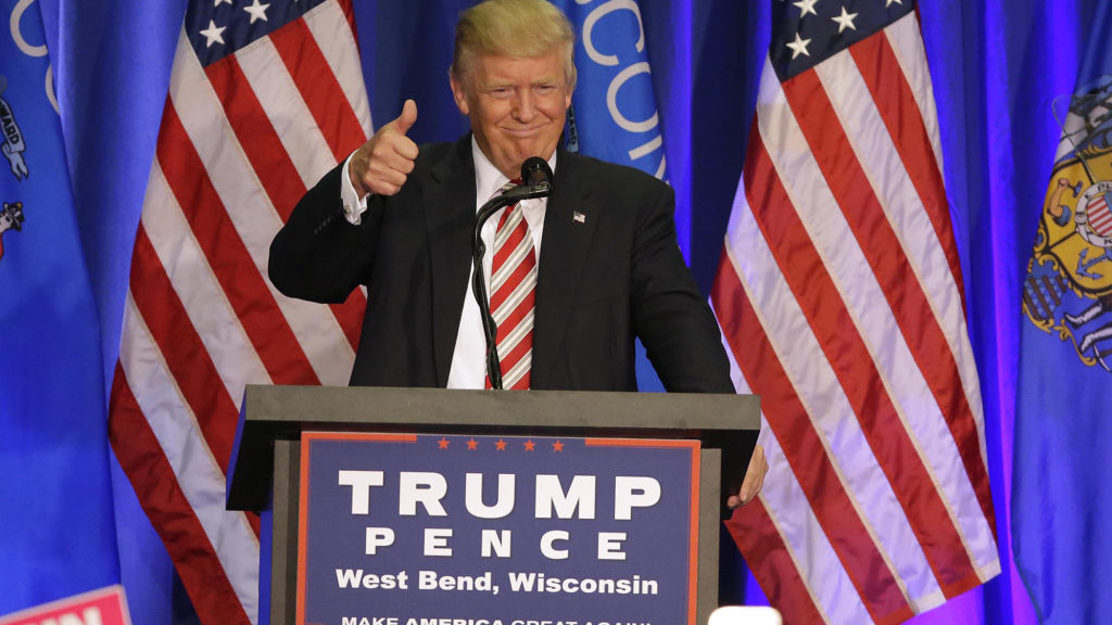 Republican presidential nominee Donald Trump greets supporters during a rally.