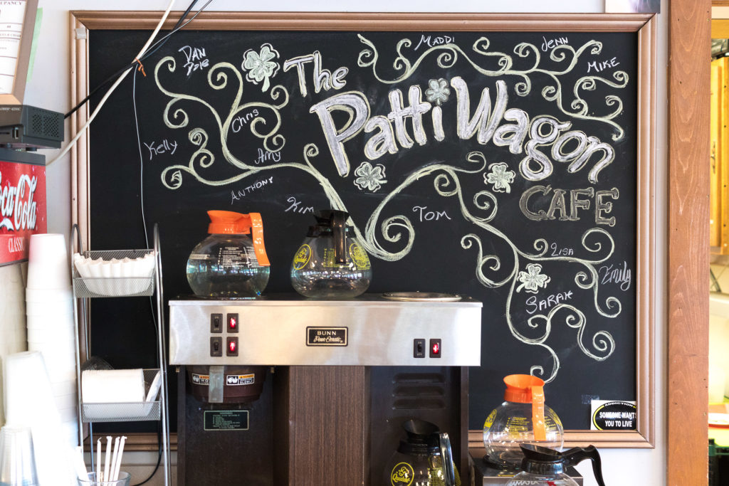 The chalkboard shows the 'family tree' of workers at Patti's