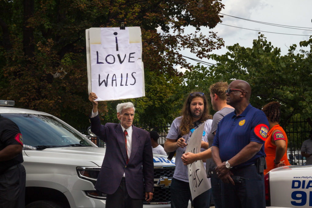 """Jerry Lambert arrived at the protest against Donald Trump's visit to Philly to support the candidate. The other side of his sign read,  """"Democrats for Trump."""" (Kaylee Tornay/Billy Penn)"""