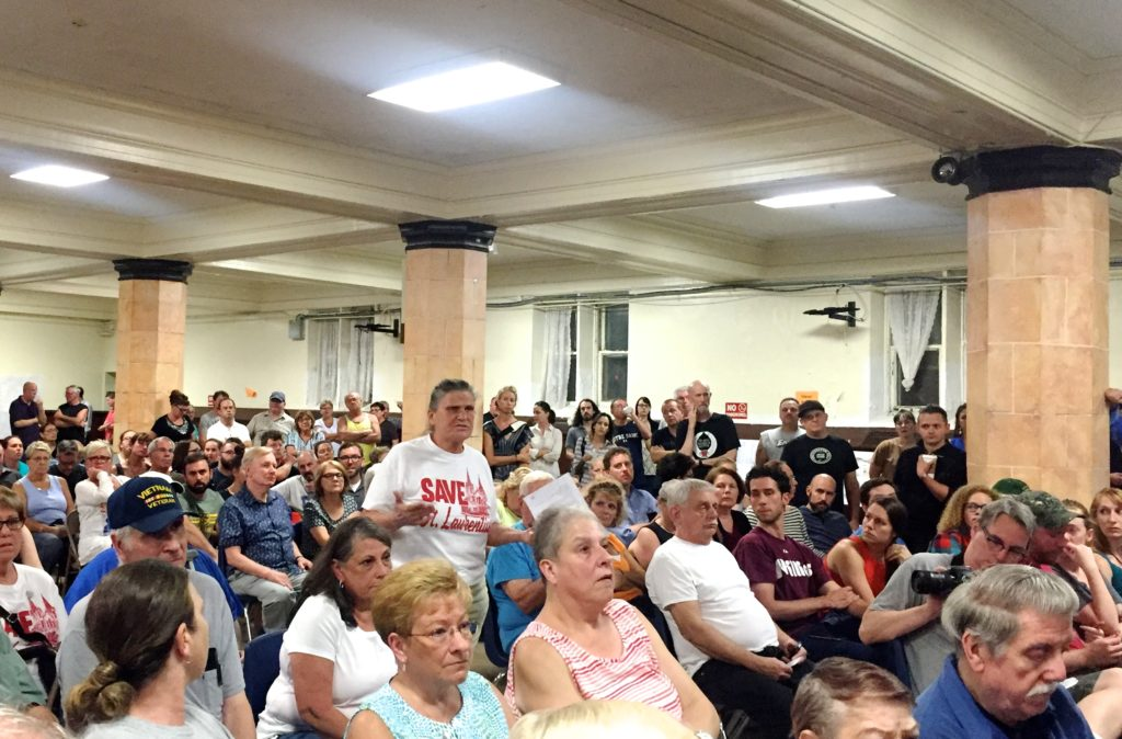 A woman speaks out against turning St. Laurentius into a 23-unit apartment building.