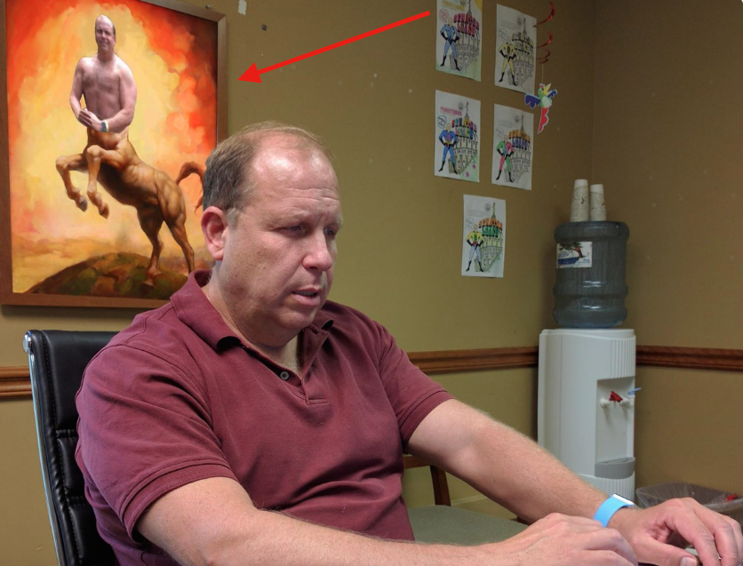 State Sen. Daylin Leach, D-Montgomery, sits in front of a photo of himself as a centaur.