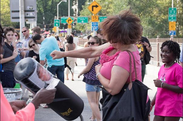 A woman strikes a Donald Trump punching bag at a July Brooklyn rally.
