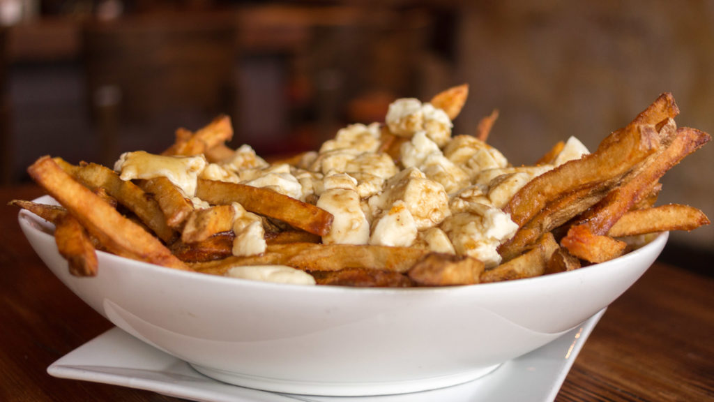 Fries + curds + gravy = poutine (shown here at Blind Pig in Northern Liberties)