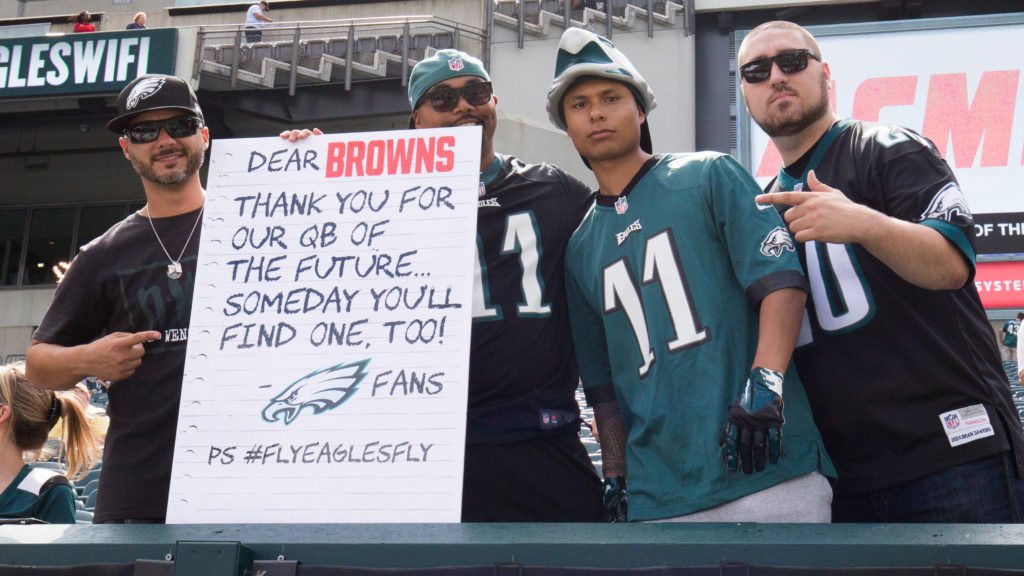 These bros would totally get on TV with that sign this week.