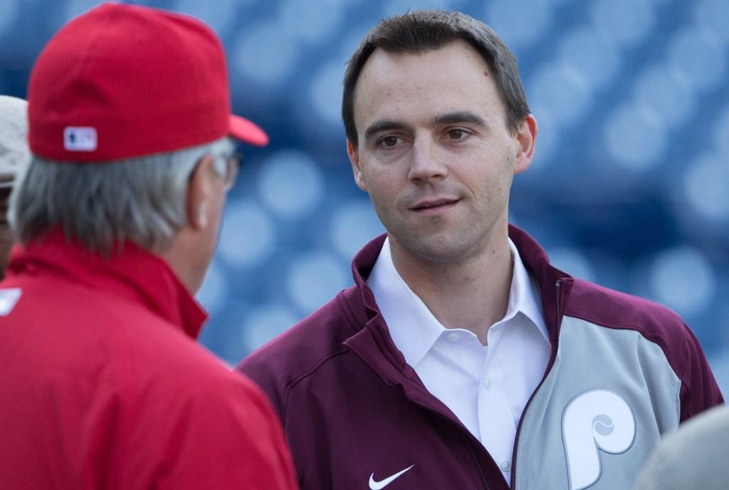 Phillies general manager Matt Klentak talks with manager Pete Mackanin