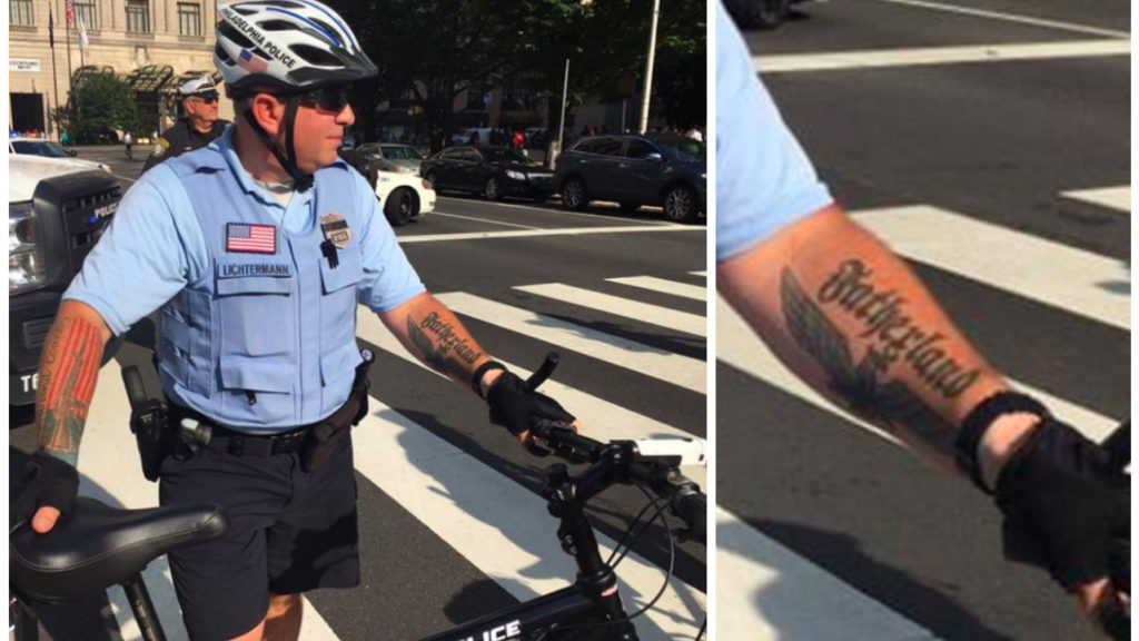 A Facebook user identified as Evan Parish Matthews posted this photo depicting a Philadelphia Police Officer with what appears to be a Nazi-inspired tattoo.