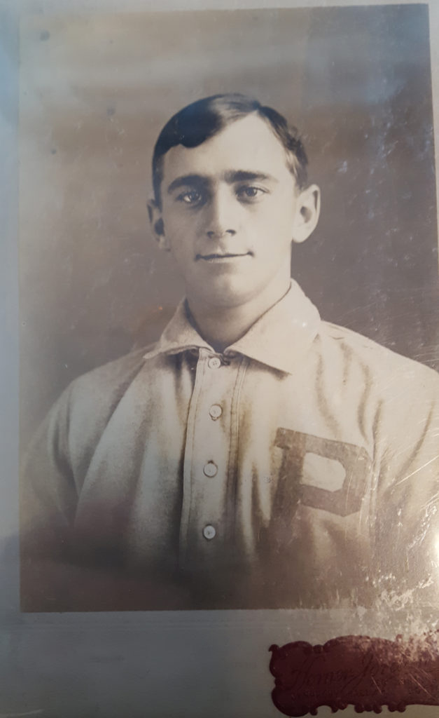 A Sherry Magee tobacco card with his name covered over because it was spelled incorrectly.