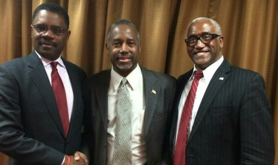 Calvin Tucker, left, stands with former presidential candidate Ben Carson and 2nd congressional district candidate James Jones.
