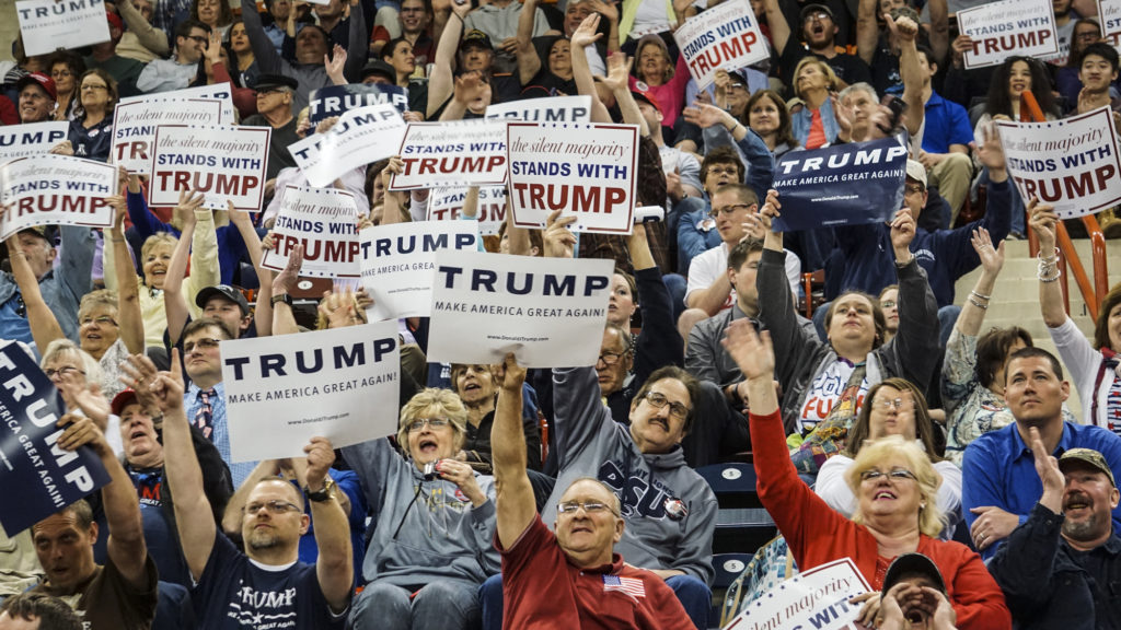 Members of the audience cheer during a campaign rally for Republican presidential candidate Donald Trump at the Pennsylvania Farm Show Complex in Harrisburg.