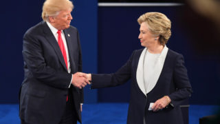 Oct 9, 2016; St. Louis, MO, USA;  Democratic presidential candidate Hillary Clinton and Republican presidential candidate Donald Trump shake hands after the second presidential debate at Washington University in St Louis. Mandatory Credit: Jack Gruber-USA TODAY NETWORK