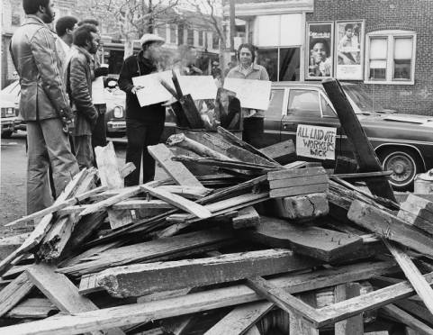 """During the '77 strike: """"SEPTA strikers get ready for caravan that will descend on SEPTA board meeting. Planning for a long strike strikers gather around fire with plenty of firewood."""""""
