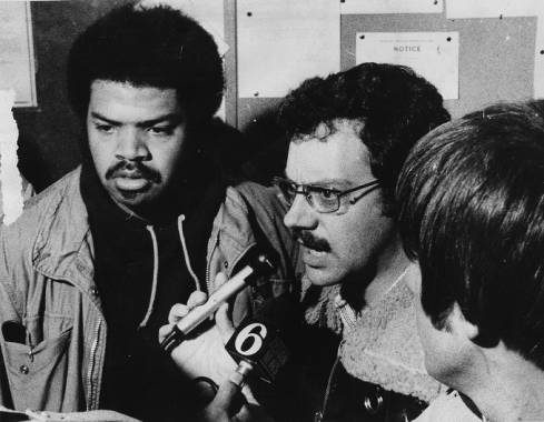 """From the '77 strike: """"SEPTA workers Dwight Newman (left) and Robert Tauss discuss the issues at the 20th and Johnston sts. depot."""""""