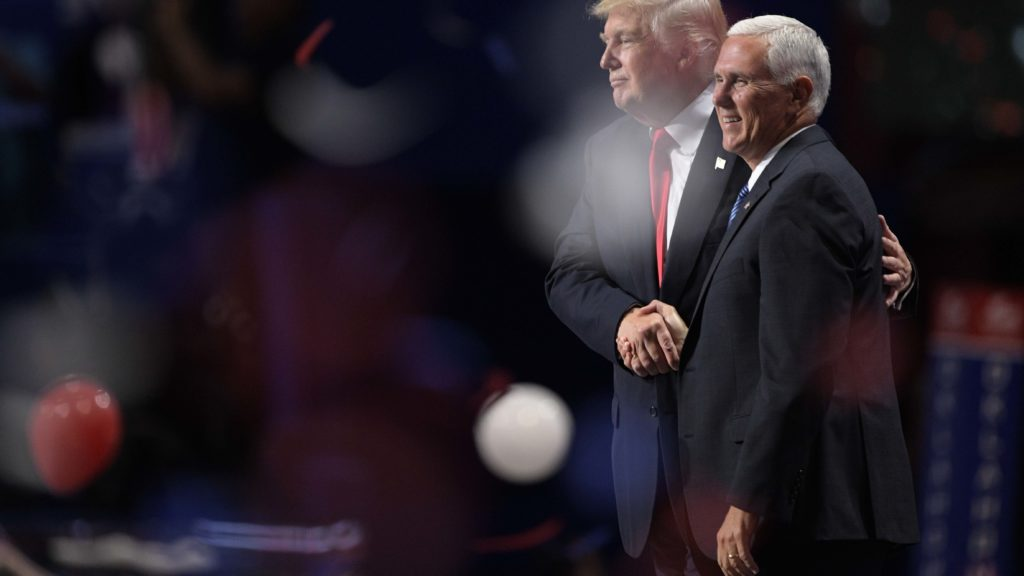 Donald Trump and Mike Pence shake hands after Trump's speech during the 2016 Republican National Convention at Quicken Loans Arena.